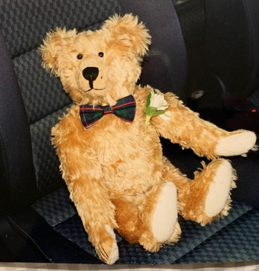 Bertie dressed as the Best Man sat in a seat in the car.