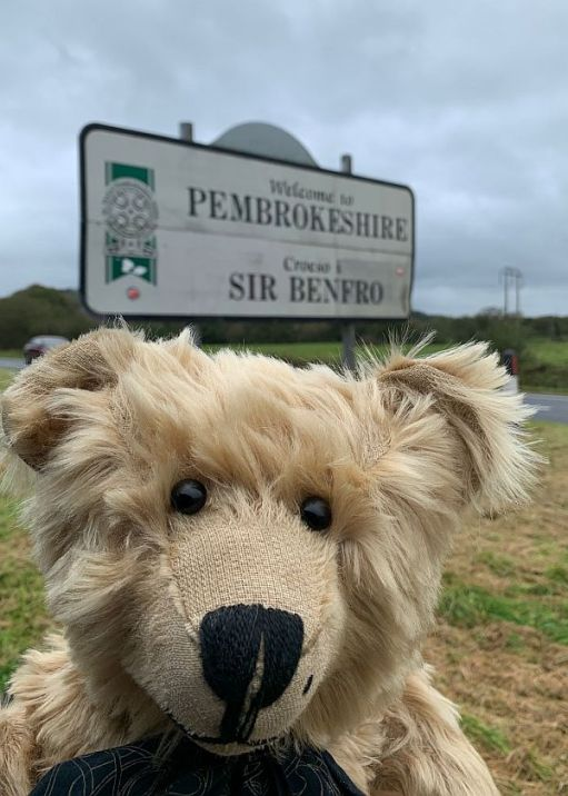 Bertie by the street sign for Pembrokeshire (Sir Benfro).