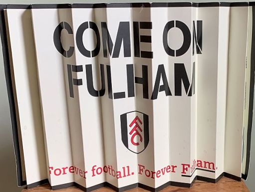 "A ""Come on Fulham"" banner."