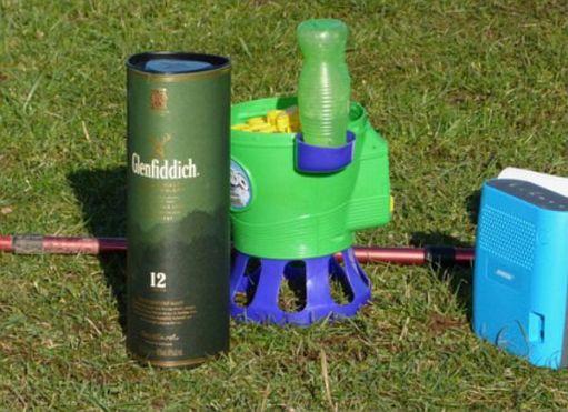 A box of Glenfiddich, a child's bubble machine and a portable radio.