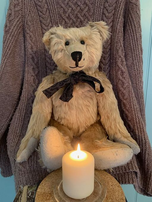 Bertie sat on the Aran Jumper with a Candle lit for Diddley and Wndy in front of him.