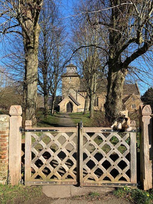 Wotton Church as seen through the ornate entrance gate.