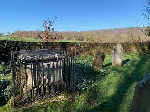 Tomb with iron railings around.