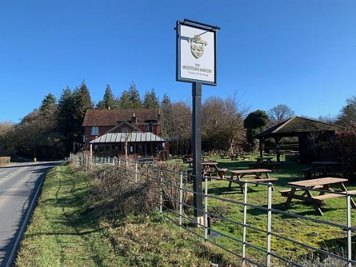 The Wotton Hatch pub. Close to the church on the A25.