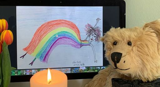 Bertie and a candle lit for Diddley in front of one of Kate's pictures.