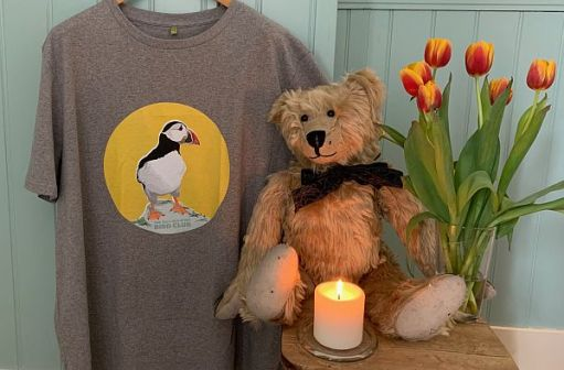 Bertie, with some tulips and a candle lit for Diddley, along with Bob's Self-Isolating Bird Club T-Shirt. (XXL)