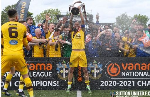 Players and fans of Sutton United celebrating their victory.