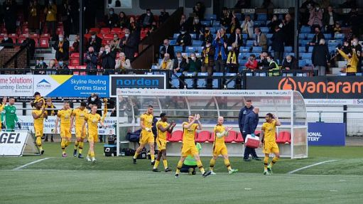Sutton United team coming onto the ground.