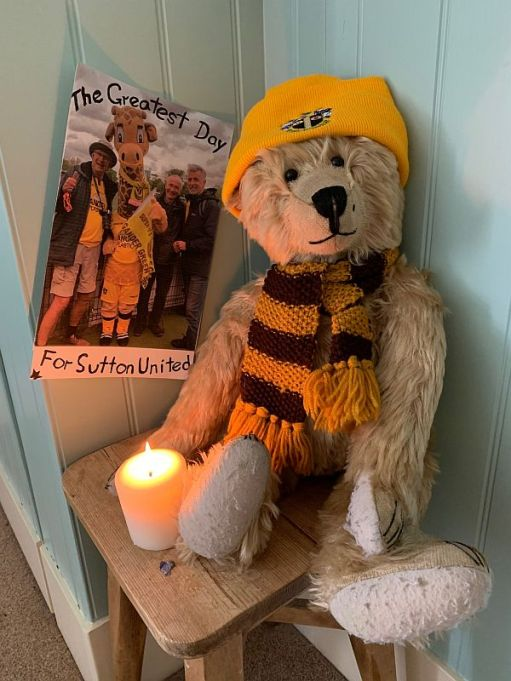 Bertie is his Sutton United strip with a candle lit for Diddley.