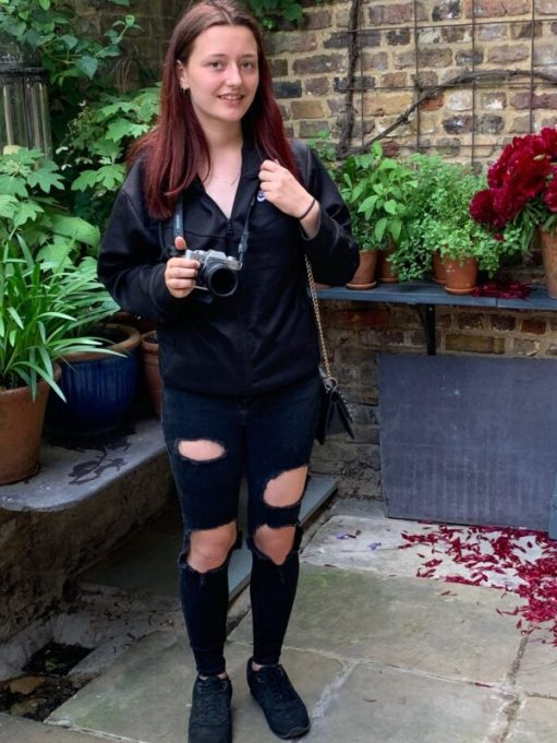Amber with camera and blackholey trousers!