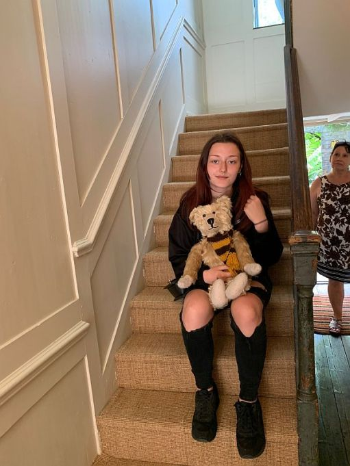 Amber sat on the stairs with Bertie. Ann is in the background.