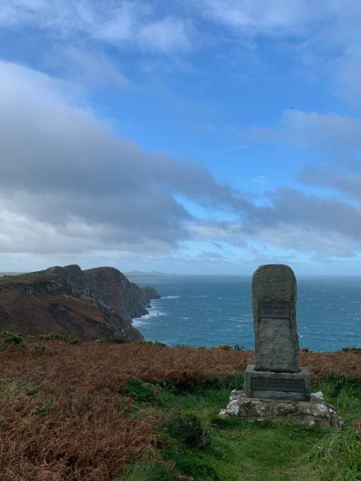 Memorial to Dewi Emrys and looking out to the sea.