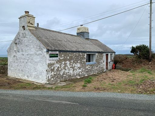 Slightly run-down cottage for sale.