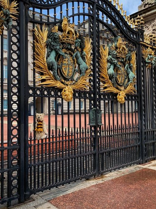 Bertie sat on the gates of Buckingham Palace.
