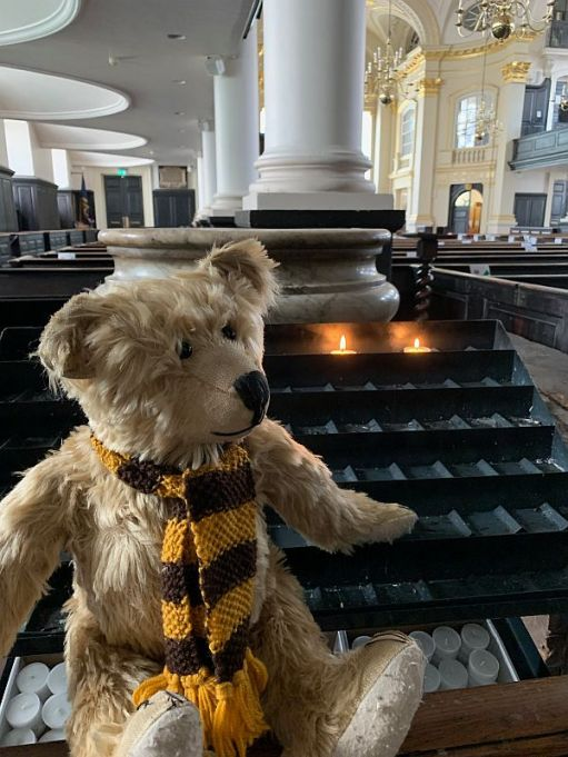 Bertie in St-Martin-in-The-Fields Church with candles lit for Diddley and Peter.