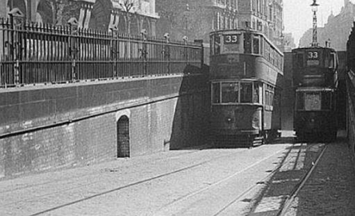 Two No33 trams - one ascending from, the other descending into, the Kingways Tram Tunnel.