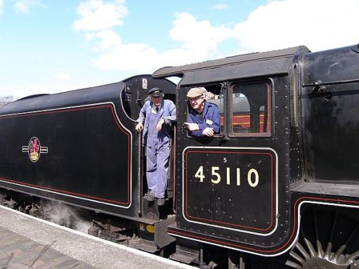 Bobby on the footplate of Black 5 45110 with his driving instructor.