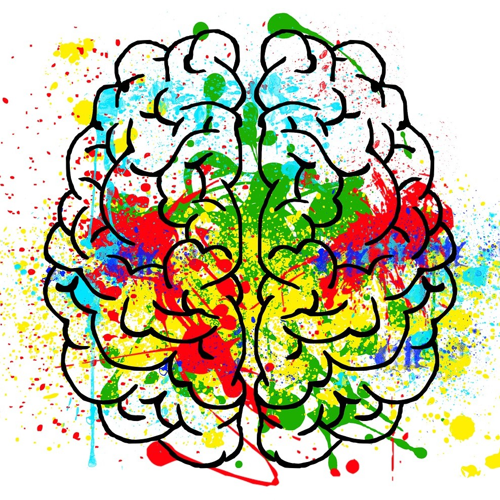 illustration of a brain with brightly coloured paint splashed and splattered around and across it