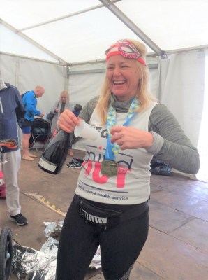 a runner smiles in the mindout tent for brighton marathon 2018