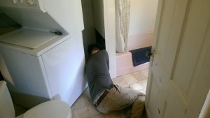Craig, wedged behind a bathtub, where we thought for a bit Steve might have gotten stuck.
