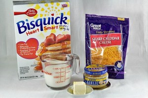 Easy Cheesy Drop Biscuits are light and fluffy with a hint of garlic, topped with butter. Heart Smart Bisquick makes them super simple and fast to make.