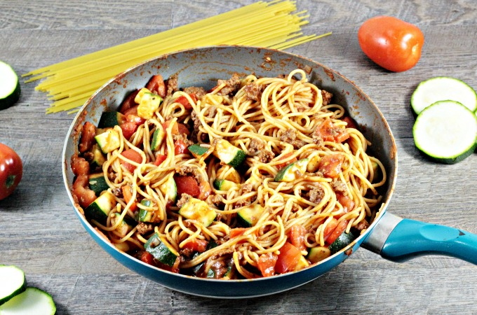 Spaghetti with Zucchini & Tomatoes combines pasta, ground beef, onions, tomato sauce, seasonings, zucchini, and tomatoes. It is fast and healthy.