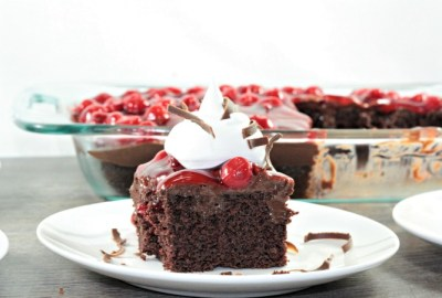 Black Forest Poke Cake features boxed cake mix, chocolate pudding, cherry pie filling, Cool Whip, and shaved chocolate. An easy and delicious dessert.