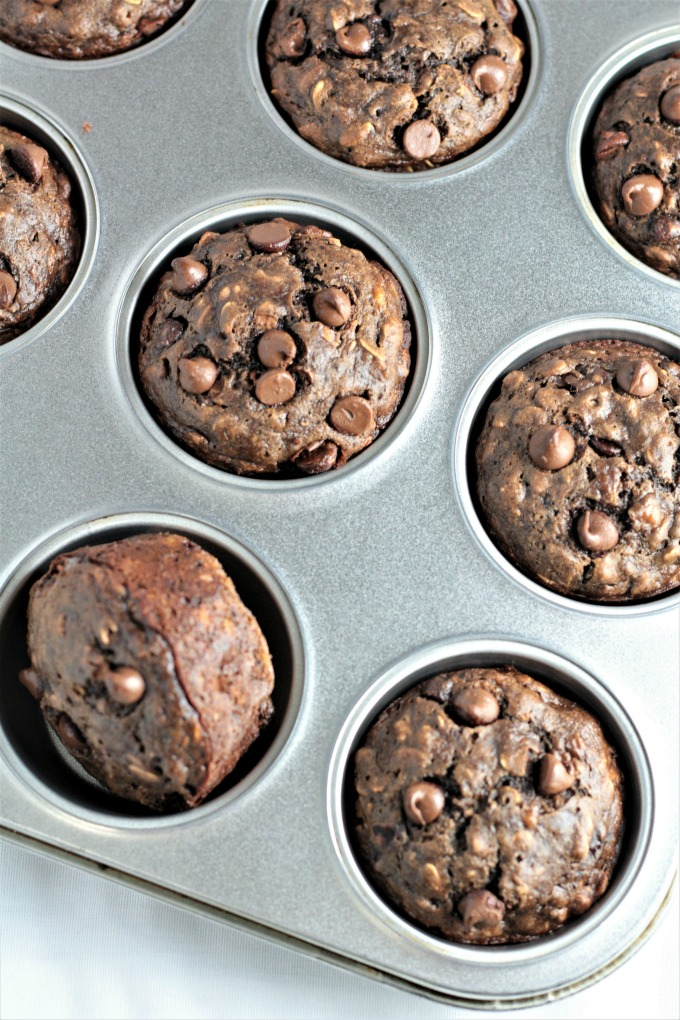 Double Chocolate Banana Oatmeal Muffins have oats, cocoa, buttermilk, applesauce, and chocolate chips. They are chocolatey, moist, easy, and quick.