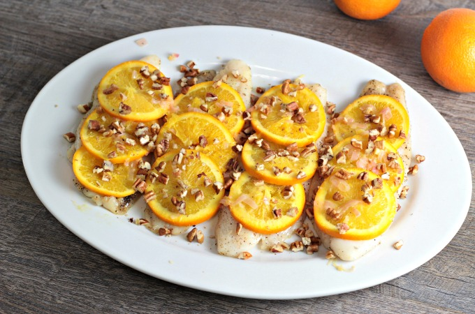 Pan Fried Fish with Oranges and Pecans features white fish, shallots, white wine vinegar, orange juice, and butter. A quick, easy, and healthy dish.