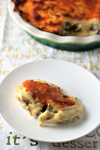 Cheesy Scalloped Potatoes feature thinly slice layered potatoes topped with a cheesy béchamel sauce made of milk, butter, flour, onion, and cheese.