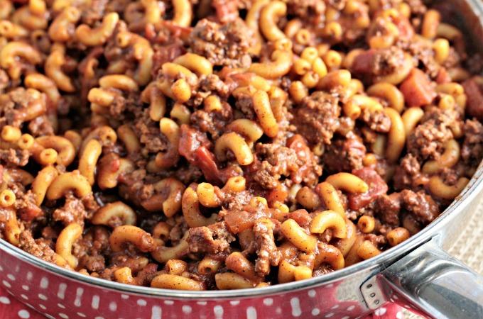 Homemade Hamburger Helper Chili Mac is healthier and only requires ground beef, macaroni, tomatoes, tomato sauce, chili seasoning, milk, and water.