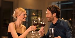 Romantic,Young,Couple,At,Restaurant,Raising,A,Toast.,Beautiful,Couple