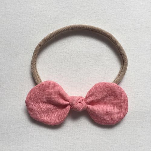 Βρεφική κορδέλα μαλλιών με ροζ φιόγκο