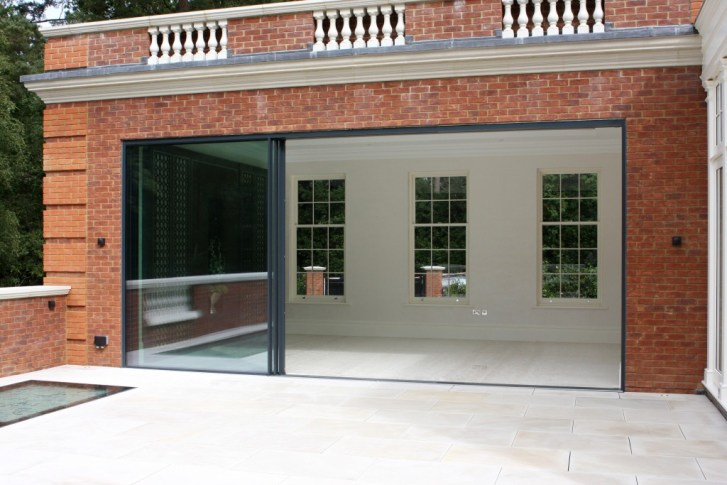 Case study foxwood featuring slim framed sliding glass for Non sliding patio doors