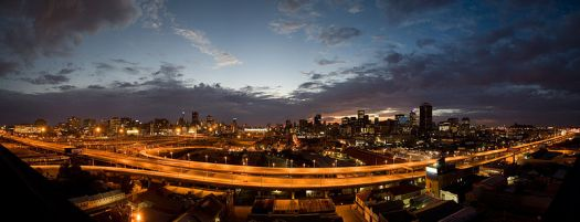 A panorama of Johannesburg at sunrise looking east across the M1 highway. Source: wikipedia African national grids