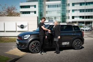 New MINI UK ambassador and rally driver Harry Hunt receives the keys for his MIN JCW Countryman from MINI UK's General Manager Brand Communications Michelle Roberts