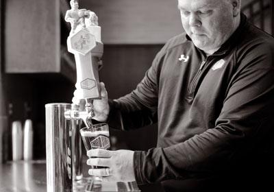 man pouring beer photo