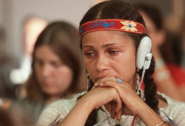 woman listening to head phones