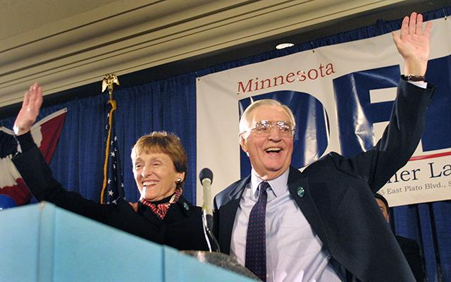 Joan and Walter Mondale waving to supporters on Election Night in 2002.