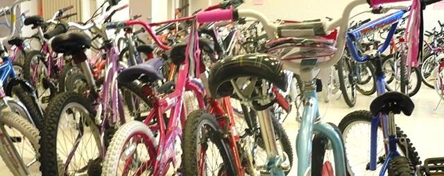 People at Free Bikes 4 Kidz corral volunteers to repair and shine up bikes, then