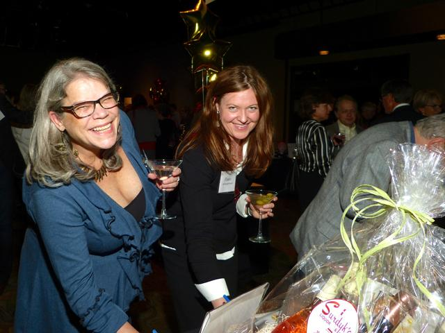 Tamara Blaschko and Fawn Bernhardt-Norvell bidding on auction items