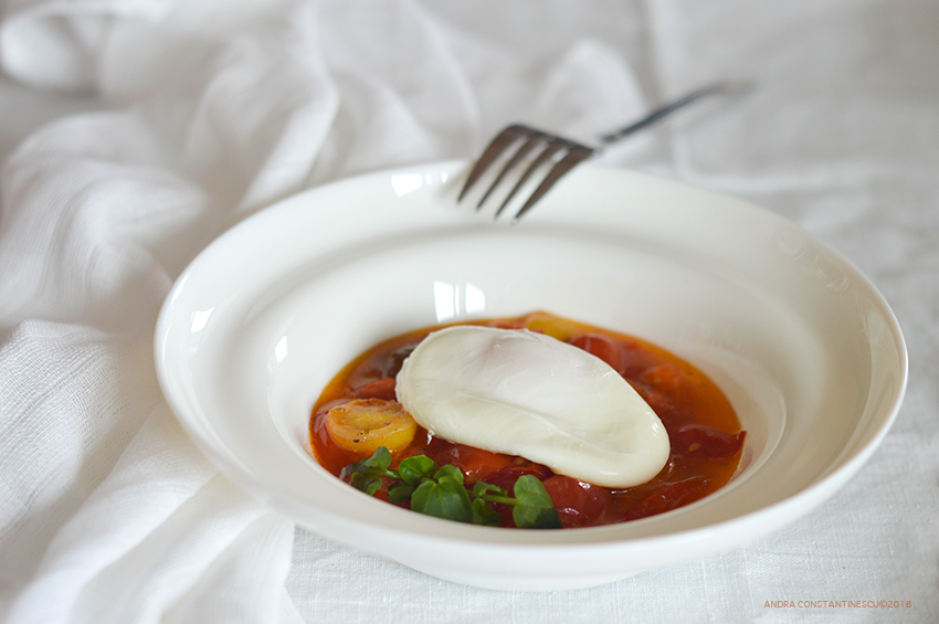 Confit tomato and poached eggs on a white plate for a low calorie dinner