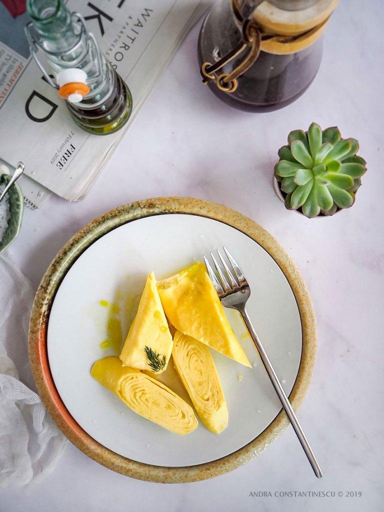 Japanese Omelette also known as Tamagoyaki - served for breakfast on a white porcelain plate