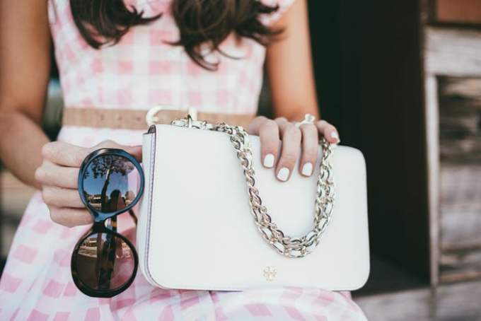 the prettiest little ivory tory burch bag!