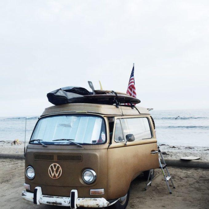 vintage VW van on the beach with american flag