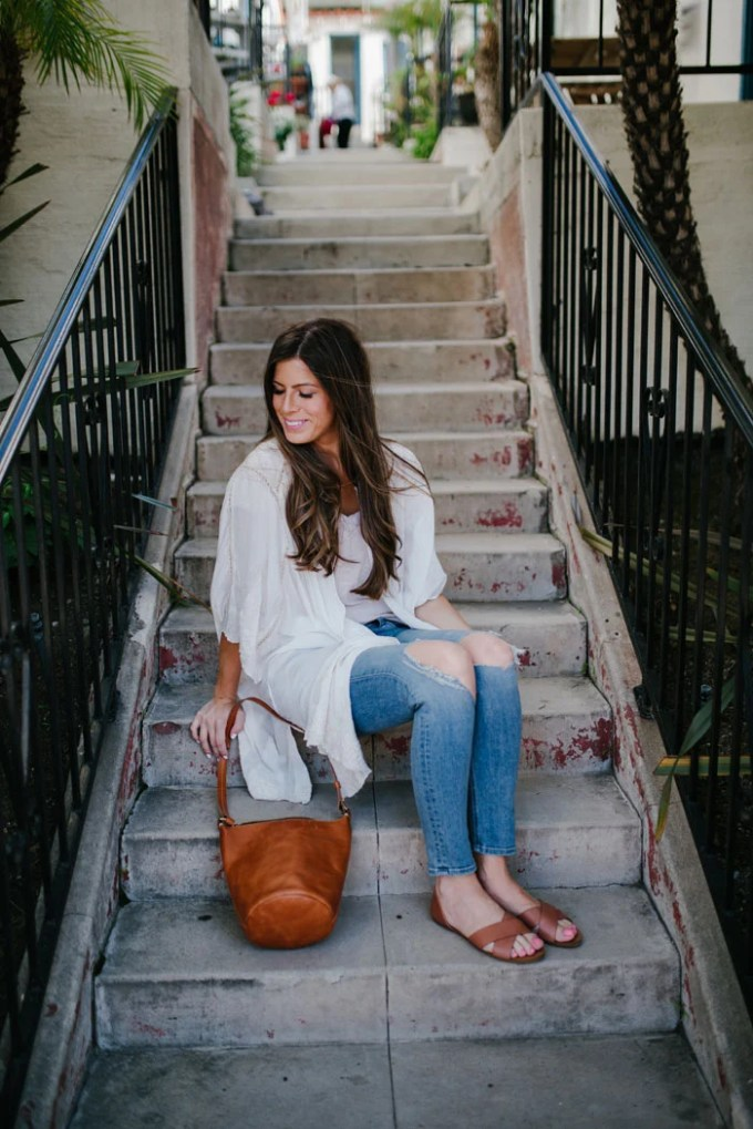 white top and distressed jeans