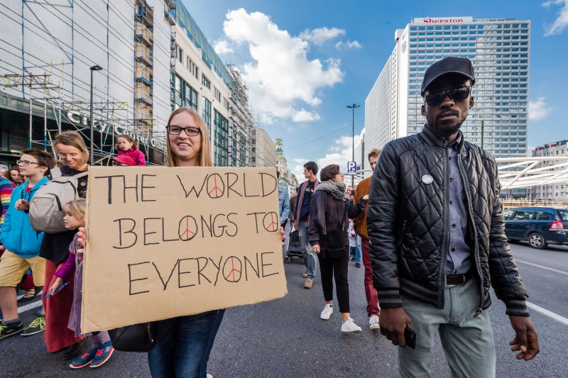 People walk during a solidarity march for refugees in Brussels on Sunday, Sept. 27, 2015. About 15,000 people marched to ask for respect, dignity and humane shelter for refugees in Belgium and Europe. (AP Photo/Geert Vanden Wijngaert)