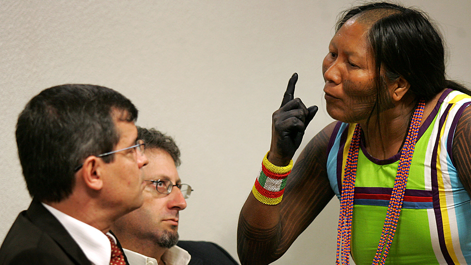 Tuira Kayapo, right, leader of the indigenous Kayapo tribe, speaks to Aloysio Guapindaia, left, director of the National Indian Foundation, FUNAI, during a public hearing at the Commission of Human Rights of the Federal Senate in Brasilia, Wednesday, Dec. 2, 2009. Native communities of the Amazon rain forest are protesting the Brazilian government's decision to build the massive hydroelectric Belo Monte dam in the Xingu River. (AP Photo/Eraldo Peres)