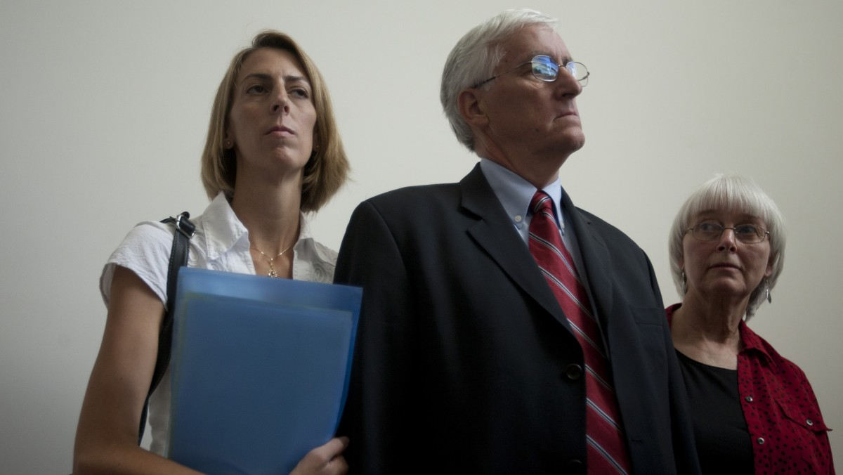 Cindy, right, and Craig Corrie, the parents of Rachel Corrie, a pro-Palestinian activist who was killed by an Israeli bulldozer in Gaza in 2003, stand together with their daughter Sarah after the district court's ruling in Haifa, Israel, Tuesday, Aug. 28, 2012. (AP Photo/Ariel Schalit)
