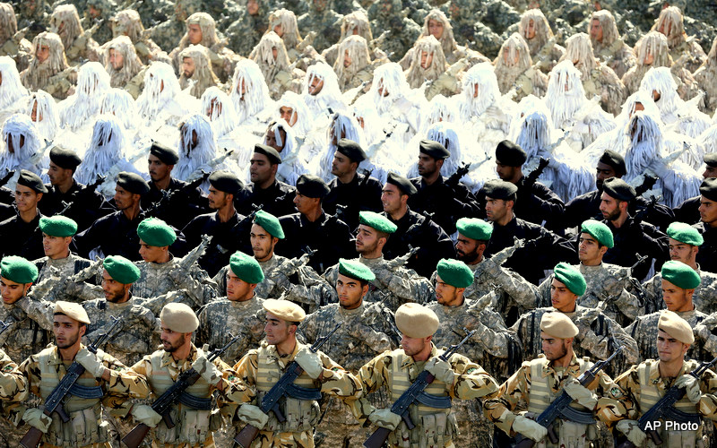 Members of the Iran's armed forces, some wearing ghilli suits, march during an annual military parade marking the 34th anniversary of outset of the 1980-88 Iran-Iraq war, in front of the mausoleum of the late revolutionary founder Ayatollah Khomeini just outside Tehran, Iran, Monday, Sept. 22, 2014.